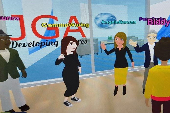 The avatars of some team members greet each other in the virtual world virbela